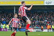 Goal Lincoln City Defender Scott Wharton  celebrates as he makes it 3-0 during the EFL Sky Bet League 2 match between Lincoln City and Grimsby Town FC at Sincil Bank, Lincoln, United Kingdom on 17 March 2018. Picture by Craig Zadoroznyj.