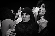 Egypt, Cairo: Muslim women react after the ritual of exorcism  in Deyr el Qiddis Samaan (Monastery of St.Simon) in Manshyet Naser el Moqattam. ph.Christian Minelli..