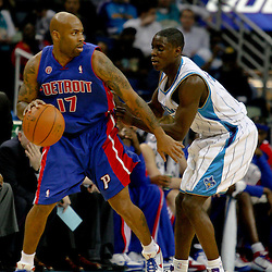 Dec 16, 2009; New Orleans, LA, USA;  Detroit Pistons guard Chucky Atkins (17) is guarded by New Orleans Hornets guard Darren Collison (2) during the first half at the New Orleans Arena. Mandatory Credit: Derick E. Hingle-US PRESSWIRE