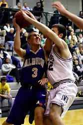 30 December 2006: Tyler Smith hacks Zak Silas as Silas shoots.The Titans outscored the Britons by a score of 94-80. The Britons of Albion College visited the Illinois Wesleyan Titans at the Shirk Center in Bloomington Illinois.<br />