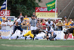 Virginia defensive end Chris Long (91) tries to scoop up a Wyoming fumble.  The ball was picked up by Virginia linebacker Darnell Carter (42).  The Wyoming Cowboys defeated the Virginia Cavaliers 23-3 at War Memorial Stadium in Laramie, WY on September 1, 2007.