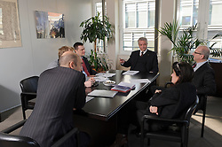 Manfred Bergmann, the European Commission's Directorate General for Taxation and Customs Union, meets with his team, in Brussels, on Monday, Feb. 6, 2012. (Photo © Jock Fistick)