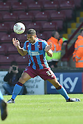 Jordan Clarke of Scunthorpe United heads forward  during the Sky Bet League 1 match between Scunthorpe United and Burton Albion at Glanford Park, Scunthorpe, England on 9 April 2016. Photo by Ian Lyall.
