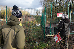 Harefield, UK. 17 January, 2020. Activists from Stop HS2 and Extinction Rebellion observe a build-up of ground water close to where trees have been felled by HS2 at the beginning of a three-day 'Stand for the Trees' protest in the Colne Valley. The event has been timed to coincide with tree felling work by HS2 adjacent to the site of Stop HS2's Colne Valley wildlife protection camp. Bailiffs acting for HS2 have been evicting Stop HS2 activists from the camp for the past week and a half. 108 ancient woodlands are set to be destroyed by the high-speed rail link.