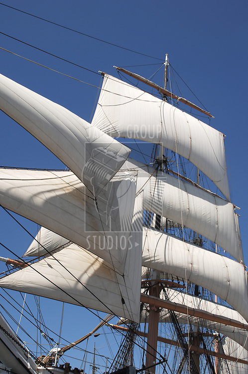 white billowing sails from a vintage tall ship