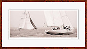 Art photography of wooden 12 Metre Class America's Cup sailboats in a sailing race.