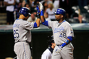 Sept. 24, 2010; Cleveland, OH, USA; Kansas City Royals first baseman Kila Ka'aihue (25) congratulates third baseman Wilson Betemit (46) after he hit a two run home run during the ninth inning against the Cleveland Indians at Progressive Field. The Indians beat the Royals 7-3. Mandatory Credit: Jason Miller-US PRESSWIRE