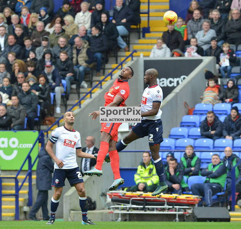 Fode Koita of Rovers wins an aerial battle against Prince-Desire Gouano of Bolton .....(c) BILLY WHITE | SportPix.org.uk