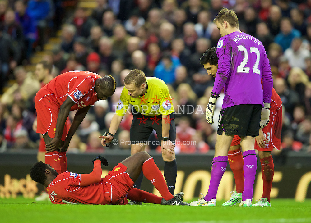 LIVERPOOL, ENGLAND - Thursday, New Year's Day, January 1, 2015: Liverpool's Kolo Toure goes down with an injury to his left leg against Leicester City during the Premier League match at Anfield. (Pic by David Rawcliffe/Propaganda)