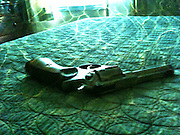 Ruger .357 magnum lying on bed