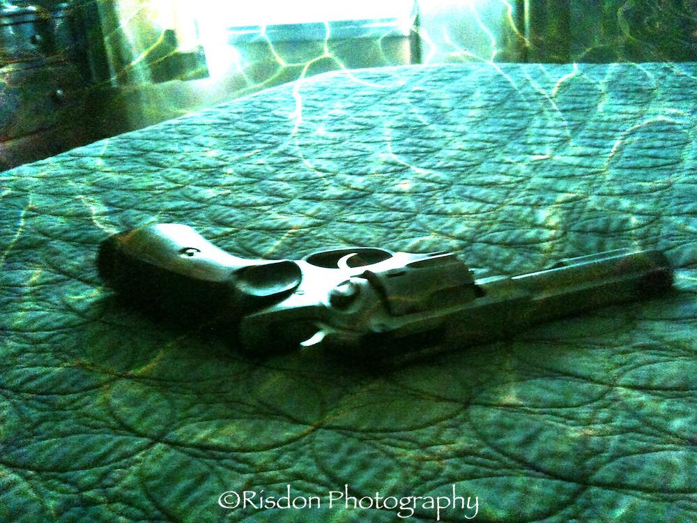Ruger .357 magnum lying on bed