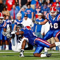 December 4, 2010; Ruston, LA, USA;  Nevada Wolf Pack wide receiver Malcolm Shepherd (19) is tackled by Louisiana Tech Bulldogs linebacker Jay Dudley (45) during the first half at Joe Aillet Stadium.  Mandatory Credit: Derick E. Hingle