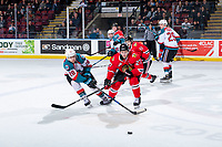 KELOWNA, CANADA - MARCH 2:  Jared Freadrich #27 of the Portland Winterhawks stick checks Leif Mattson #28 of the Kelowna Rockets as he passes the puck during second period on March 2, 2019 at Prospera Place in Kelowna, British Columbia, Canada.  (Photo by Marissa Baecker/Shoot the Breeze)