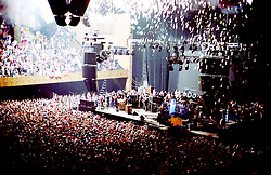 Bill Graham as Father Time Hits the Stage. The Grateful Dead on New Years Eve at the Stroke of Midnight. The Dead in Concert at the San Francisco Civic Auditorium, 31 December 1984 into 1 January 1985. Just as the Third Set Begins. Shot on Color Negative Film, Kodak CM135-36.
