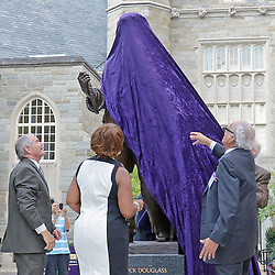 Photos by Tom Kelly IV<br /> Clifford DeBaptiste (right), West Chester University President Greg Weisenstein (left) and Mildred Joyner (center) unveil the statue during the dedication of the Frederick Douglass statue at West Chester University, Tuesday afternoon October 1, 2013.
