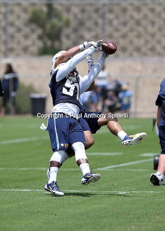 San Diego Chargers rookie linebacker Jatavis Brown (57) breaks up a pass play during the Chargers 2016 NFL minicamp football practice held on Tuesday, June 14, 2016 in San Diego. (©Paul Anthony Spinelli)