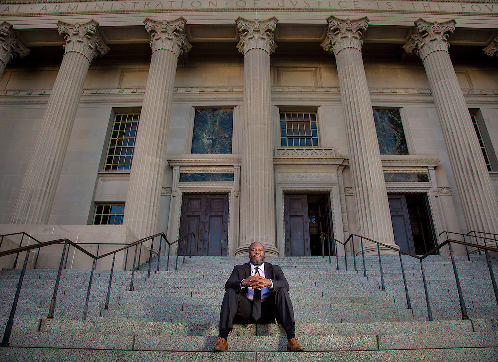 Derwyn Bunton is the Orleans Public Defender. He is standing in fron of the courthouse in New Orleans.