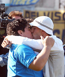 29/08/04 ? BOCA JUNIORS (2) Vs. RACING (1) - Football - Bs.As. - Argentina. Fourth match of the Torneo Apertura 2004. .DIEGO MARADONA AND CARLOS TEVEZ (BOCA PLAYER) attended the match..Here, MARADONA giving a kiss to TEVEZ..©PikoPress