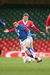 CARDIFF, WALES - WEDNESDAY, MARCH 1st, 2006: Wales' Craig Bellamy and Paraguay's captain Roberto Acuna during the International Friendly match at the Millennium Stadium. (Pic by Dan Istitene/Propaganda)