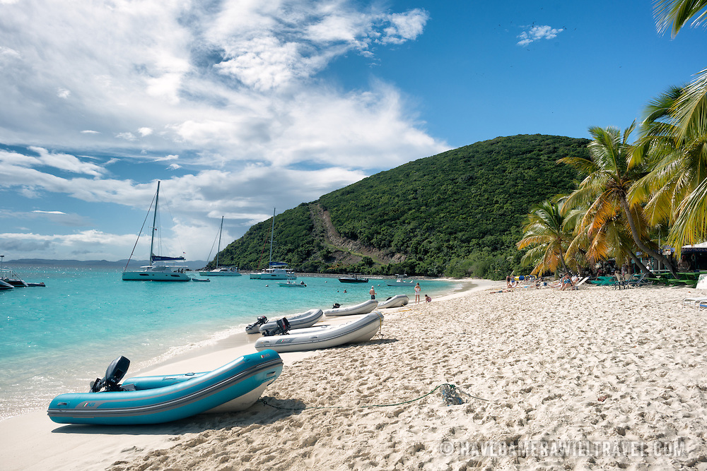 Inflateable dinghies pulled up on the beach at White Bay on Jost Van Dyke in the British Virgin Islands. The beach is famous for a string of bars serving tropical drinks, most famously the Soggy Dollar Bar.