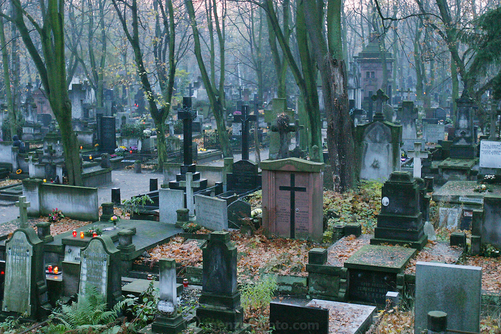 Preparing for All Saints Day. Powazek Cemetery. Warsaw, Poland. Evening of the day before.