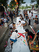 "06 JULY 2015 - BANGKOK, THAILAND: People paint a mural on a roll of paper during protest to support 14 Thai students arrested for violating rules related to a prohibition against political assembly in Thailand. More than 100 people gathered at Thammasat University in Bangkok Monday to show support for 14 students who were arrested two weeks ago. They face criminal trial in military courts. The students' supporters are putting up ""Post It"" notes around Bangkok and college campuses up country calling for the students' release.      PHOTO BY JACK KURTZ"