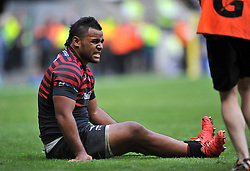 Billy Vunipola (Saracens) grimaces after suffering an injury late in the match - Photo mandatory by-line: Patrick Khachfe/JMP - Tel: Mobile: 07966 386802 31/05/2014 - SPORT - RUGBY UNION - Twickenham Stadium, London - Saracens v Northampton Saints - Aviva Premiership Final.