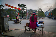 A Vietnamese woman sells lottery tickets along a street in Dien Bien Phu City, Muong Thanh Valley, Dien Bien Province, Vietnam, Southeast Asia