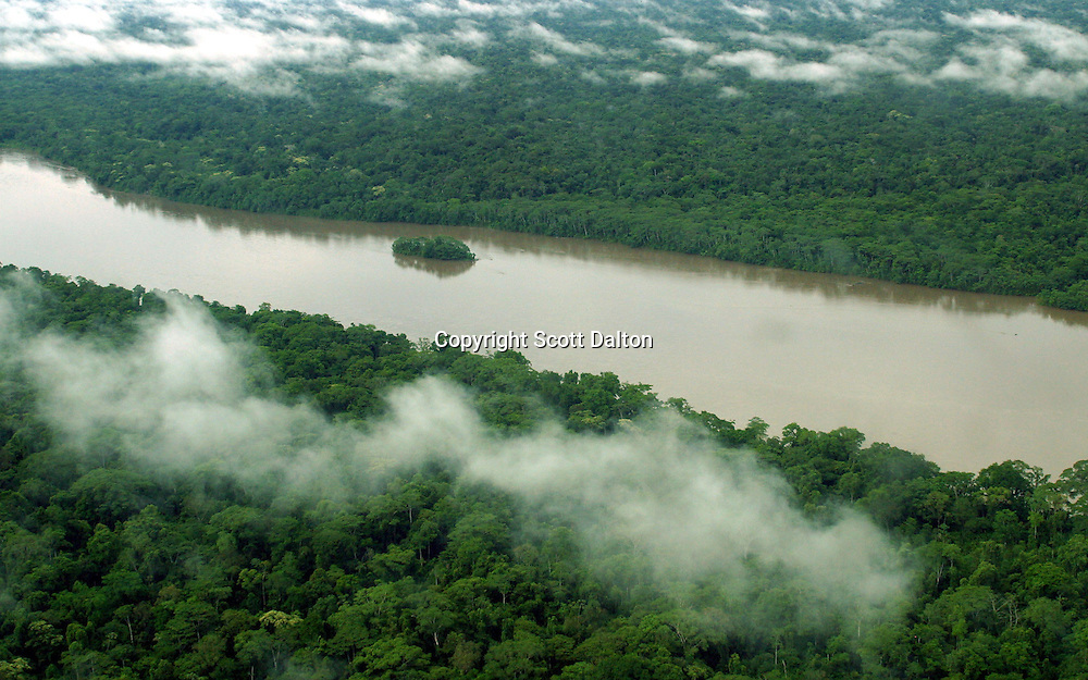 An aerial view of Achuar Indian land in Ecuador's Amazonian jungle on Tuesday, October 28, 2003. Energy companies are expanding their operations into some of the world's last undisturbed ecosystems, including searching for oil in the flat green forest of Ecuador's Amazon region.(Photo/Scott Dalton)