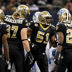 January 7, 2012; New Orleans, LA, USA; New Orleans Saints linebacker Jonathan Vilma (51) huddles up with teammates during the 2011 NFC wild card playoff game against the Detroit Lions at the Mercedes-Benz Superdome. Mandatory Credit: Derick E. Hingle-US PRESSWIRE