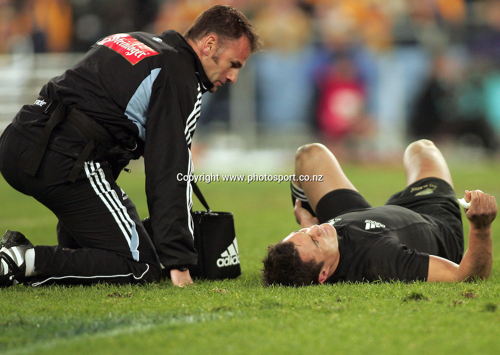 First-five Daniel Carter lies injured on the ground during the Bledisloe Cup match between the All Blacks and the Wallabies at Telstra Stadium, Sydney, Australia on Saturday 13 August, 2005. The All Blacks won the match, 30 - 13. Photo: Paul Sesier/PHOTOSPORT<br /><br /><br /><br />131821<br />dan