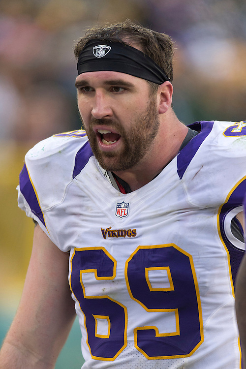 GREEN BAY, WI - DECEMBER 2:  Jared Allen #69 of the Minnesota Vikings talks on the sidelines during a game against the Green Bay Packers at Lambeau Field on December 2, 2012 in Green Bay, Wisconsin.  The Packers defeated the Vikings 23-14.  (Photo by Wesley Hitt/Getty Images) *** Local Caption *** Jared Allen