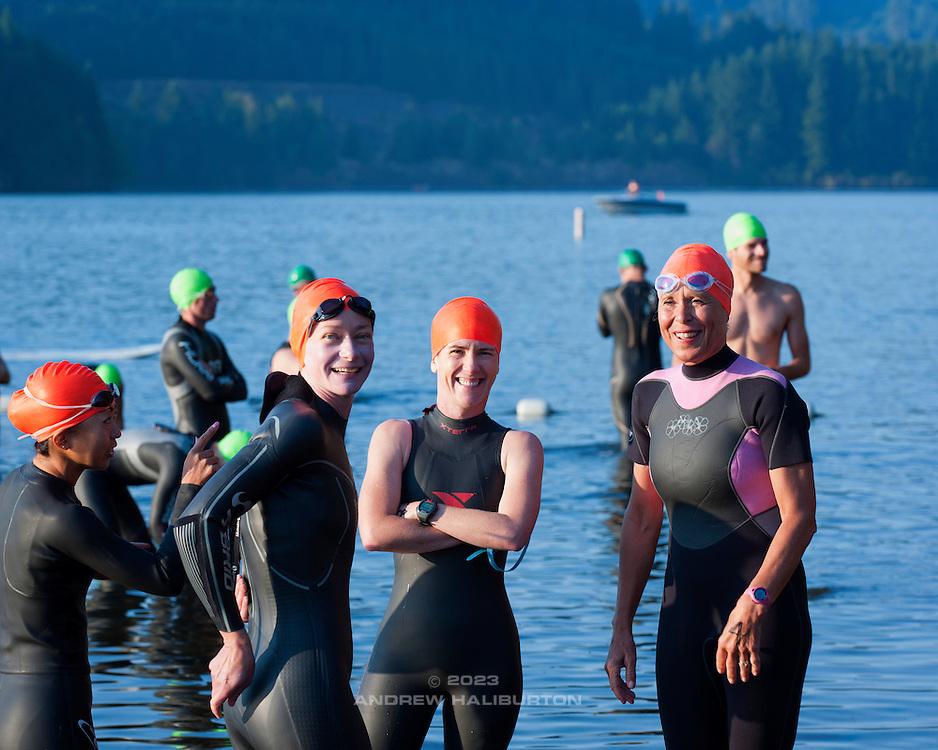 Mariko Yokote, Pam Fairchild, Melanie Haliburton and unidentified athlete await the men's start.  Best in the West Triathlon.  Half Ironman Triathlon at Foster Lake on 10 September 2011, Sweet Home, Oregon.