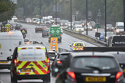 © Licensed to London News Pictures. 28/04/2020. London, UK. Traffic builds up on the A40 Park Royal in West London at 7. 20am. The public have been told they can only leave their homes when absolutely essential, in an attempt to fight the spread of coronavirus COVID-19 disease. British Prime Minister Boris Johnson, who retuned to Downing Street on Monday, has warned the public against relaxing lockdown precautions too soon. Photo credit: Ben Cawthra/LNP