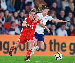 SOUTHAMPTON, ENGLAND - Friday, April 6, 2018: Wales' Rachel Rowe and England's Melissa Lawley during the FIFA Women's World Cup 2019 Qualifying Round Group 1 match between England and Wales at St. Mary's Stadium. (Pic by David Rawcliffe/Propaganda)