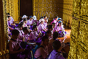 16 JULY 2014 - SAMUT PRAKAN, SAMUT PRAKAN, THAILAND: Thai students on a field trip listen to a lecture about the history of the Ayutthaya period in a reconstruction of the Sanphet Prasat Throne Hall from Ayutthaya at Ancient Siam. The original was destroyed by the Burmese when they ransacked Ayutthaya in 1767. Ancient Siam is a historic park about 200 acres (81 hectares) in size in the city of Samut Prakan, province of Samut Prakan, about 90 minutes from Bangkok. It features historic recreations of important Thai landmarks and is shaped roughly like the country of Thailand.      PHOTO BY JACK KURTZ