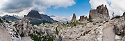 """Hike scenic and historic trails around Cinque Torri in the Dolomiti Ampezzane mountains near Cortina d'Ampezzo, Italy, Europe. Explore restored artillery bunkers and trenches from World War I conflicts between Italian and Austro-Hungarian troops. The """"Five Towers"""" (Cinque Torri or Fünf Türme) rise to 2361 meters elevation on Averau mountain in the Nuvolao group of the Dolomites. The Dolomites were declared a natural World Heritage Site (2009) by UNESCO. Panorama stitched from 11 overlapping photos."""