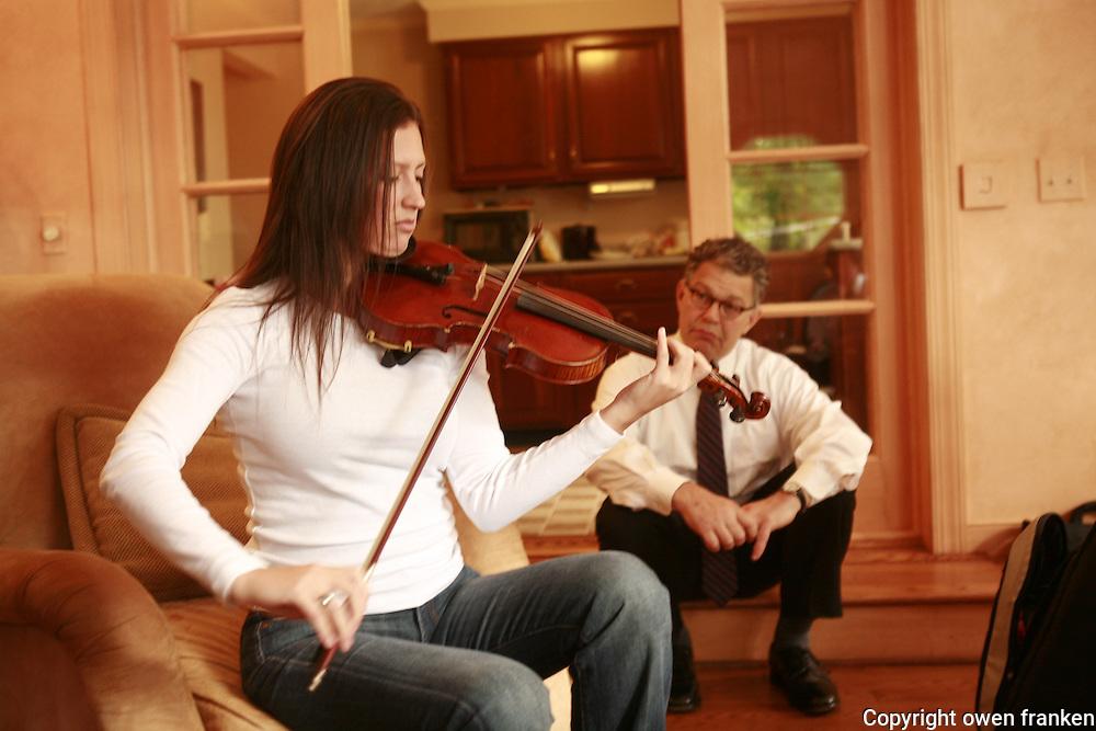 Rebedda playing violin...
