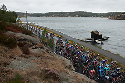The peloton speed along the shoreline at Ladies Tour of Norway 2018 Stage 2, a 127.7 km road race from Fredrikstad to Sarpsborg, Norway on August 18, 2018. Photo by Sean Robinson/velofocus.com