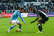 Bernardo Silva (#20) of Manchester City takes on Jetro Willems (#15) of Newcastle United during the Premier League match between Newcastle United and Manchester City at St. James's Park, Newcastle, England on 30 November 2019.