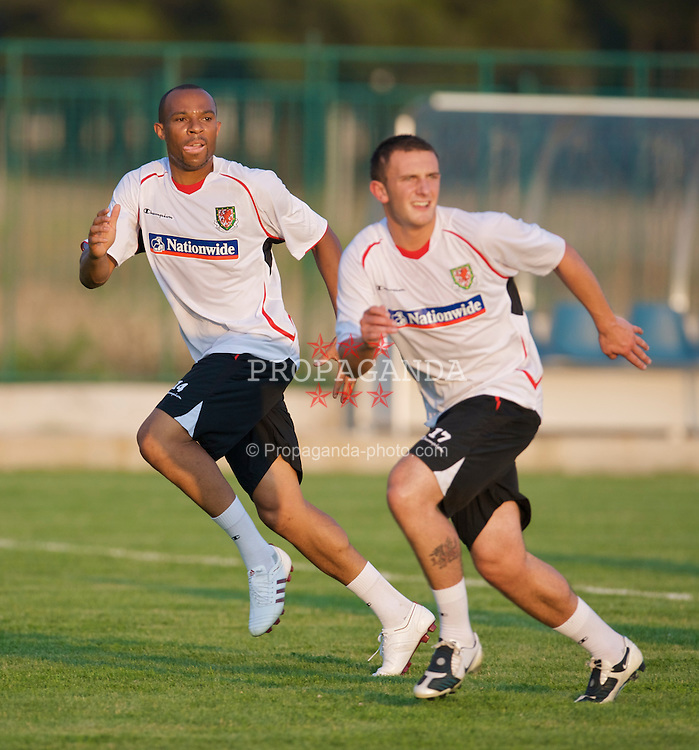 PODGORICA, MONTENEGRO - Monday, August 10, 2009: Wales' Daniel Gabbidon and Neal Eardley during a training session ahead of the international friendly match against Montenegro. (Photo by David Rawcliffe/Propaganda)