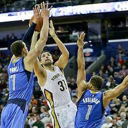 Jan 6, 2016; New Orleans, LA, USA; New Orleans Pelicans forward Ryan Anderson (33) shoots over Dallas Mavericks forward Dwight Powell (7) and guard Justin Anderson (1) during the second half of a game at the Smoothie King Center. The Mavericks defeated the Pelicans 100-91. Mandatory Credit: Derick E. Hingle-USA TODAY Sports