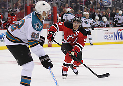 Oct 21; Newark, NJ, USA; New Jersey Devils left wing Zach Parise (9) defends against San Jose Sharks defenseman Dan Boyle (22) during the second period at the Prudential Center.
