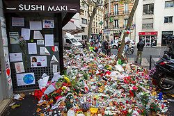 © Licensed to London News Pictures. 17/11/2015. Paris, France. Flowers left outside La Belle Équipe cafe in Paris, France following the Paris terror attacks on Tuesday, 17 November 2015. Photo credit: Tolga Akmen/LNP