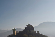 3 November 2006 - Shangarila, Yunnan - A Tibetan Buddhist temple and huge prayer wheel, apparently the largest in the world, sit on top of a hill in Shangarila's old town. Photo credit: Luke Duggleby