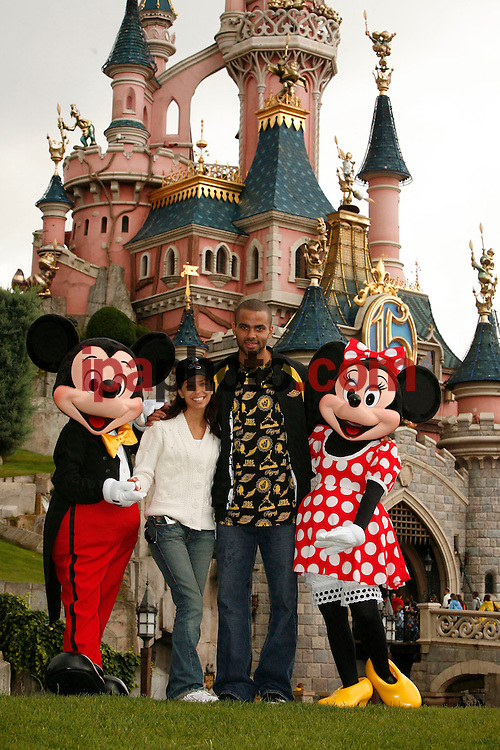 (July 4, 2007): MARNE LA VALLE, Wednesday, July 4, 2007 -- Just three days before their fairytale wedding in France, Desperate Housewives star Eva Longoria and 2007 NBA Finals M.V.P. Tony Parker celebrate their upcoming nuptials in front of the fairytale-inspired Sleeping Beauty Castle at Disneyland Resort Paris. Disney?s most famous couple, Mickey and Minnie, joined the bride and groom at the Disneyland Park to wish them many years of wedded bliss. The couple and 40 of their closest friends spent the day riding Space Mountain: Mission 2, Rock 'n' Roller Coaster starring Aerosmith and the newest attraction at the Walt Disney Studios Park, Crush's Coaster. On Saturday, Eva and Tony will celebrate their wedding a few kilometers from Disneyland Resort Paris at the famous château Vaux-Le-Vicomte. (PHOTO BY DISNEY/ IPAPHOTO.COM)