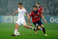 FOOTBALL - UEFA CHAMPIONS LEAGUE 2012/2013 - GROUP F - LILLE OSC v FC BAYERN MUNCHEN - 23/10/2012 - PHOTO JEAN MARIE HERVIO / REGAMEDIA / DPPI - PHILIPP LAHM (BAYERN) / NOLAN ROUX (LOSC)