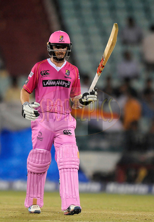 Kane Williamson of Northern Knights raises his bat after scoring a half century during match 3 of the Oppo Champions League Twenty20 between the Cape Cobras and the Northern Knights held at the Chhattisgarh International Cricket Stadium, Raipur, India on the 19th September 2014<br /> <br /> Photo by:  Pal Pillai / Sportzpics/ CLT20<br /> <br /> <br /> Image use is subject to the terms and conditions as laid out by the BCCI/ CLT20.  The terms and conditions can be downloaded here:<br /> <br /> http://sportzpics.photoshelter.com/gallery/CLT20-Image-Terms-and-Conditions-2014/G0000IfNJn535VPU/C0000QhhKadWcjYs
