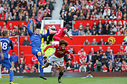 Everton striker Wayne Rooney (10) and Manchester United Defender Eric Bailly battle in the air for a header during the Premier League match between Manchester United and Everton at Old Trafford, Manchester, England on 17 September 2017. Photo by Phil Duncan.