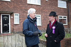 © Licensed to London News Pictures . 01/02/2014 . Manchester , UK . John Bickley on the street where he spent the first few years of his life , on Peterswood Close in Wythenshawe , with Nigel Farage . Nigel Farage , the leader of the UK Independence Party ( UKIP ) joins candidate John Bickley on the campaign trail ahead of the Wythenshawe and Sale East by-election , following the death of MP Paul Goggins . Photo credit : Joel Goodman/LNP